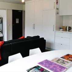 spacious lounge and kitchenette